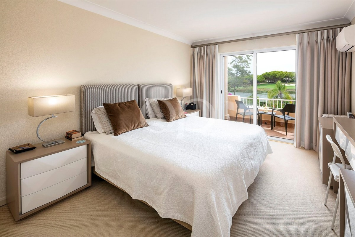 Immaculate 2-bedroom apartment with golf and lake views